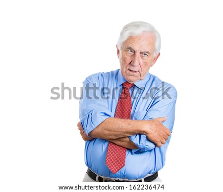 Closeup portrait of senior mature, elderly man, very unhappy and dissatisfied, in deep thought thinking of something that worries him, isolated on white background with copy space. Human emotions