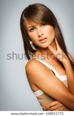 Closeup portrait of sensual female in beige dress. Shallow deep of field.