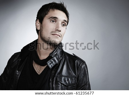 Closeup portrait of sensual man with beautiful face and eyes