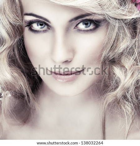 Closeup portrait of sexy whiteheaded young woman with beautiful blue eyes on light - grey  background - stock photo