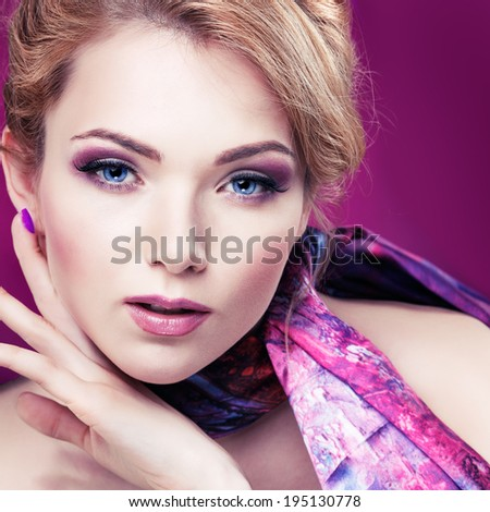 Closeup portrait of sexy  young woman with beautiful blue eyes on violet background