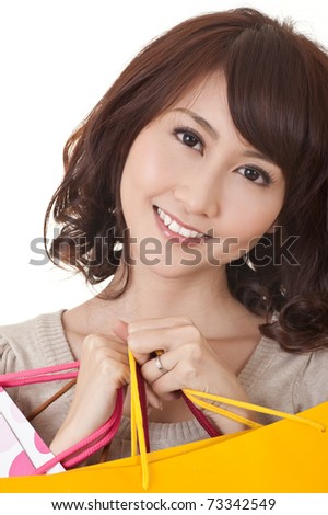 Closeup portrait of shopping woman of Asian holding bags and smiling.
