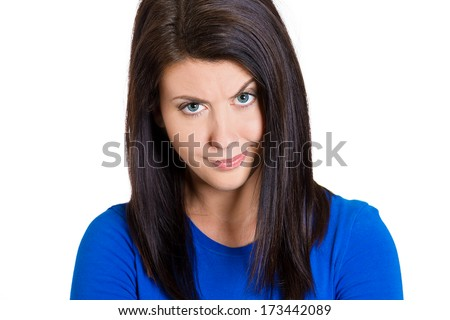 Closeup portrait of skeptical young woman looking suspicious with some disgust on her face, mixed with disapproval, isolated on white background. Negative human emotions, facial expressions, feelings