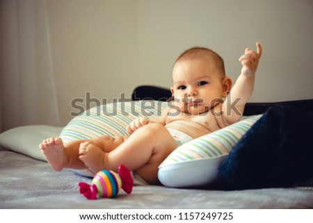 Closeup portrait of sleeping on the grey bed in diaper innocence concept #1157249725