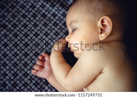 Closeup portrait of sleeping on the grey bed in diaper innocence concept #1157249731