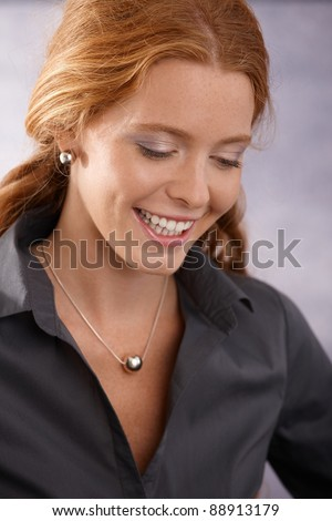 Closeup portrait of smart happy redhead woman laughing.?