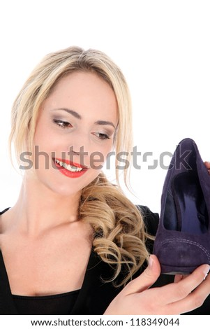 Closeup portrait of smiling blonde woman holding purple high heel on white background