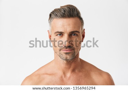 Closeup portrait of smiling half naked man 30s having bristle looking at camera isolated over white background