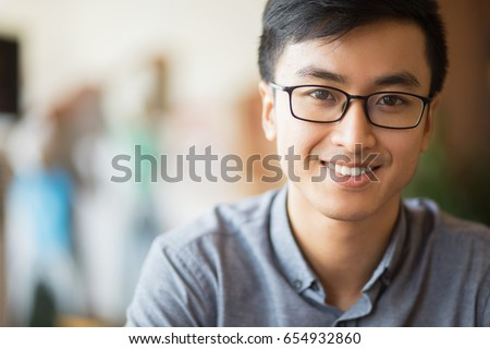 Closeup Portrait of Smiling Young Asian Man
