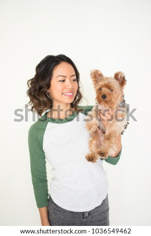Closeup portrait of smiling young attractive woman holding Yorkshire terrier. Yorkshire terrier concept. Isolated front view on white background. #1036549462