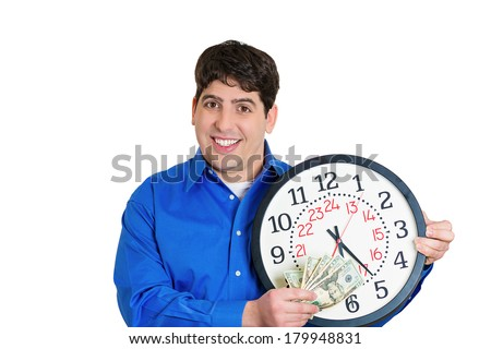 Closeup portrait of smiling young man, corporate employee worker, holding clock and dollar bills up. Time is money concept, isolated on white background. Positive emotions facial expression feelings.