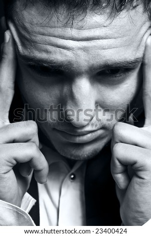 Closeup portrait of stressed businessman with headache