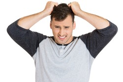 Closeup portrait of stressed, frustrated, crazy man, pulling his hair out, having panic attack, isolated on white background. Negative human face expressions, emotions, feelings, attitude, perception