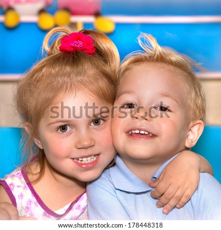 Closeup portrait of two cheerful child hugging each other, adorable siblings, smiling faces, best friends, love and friendship concept