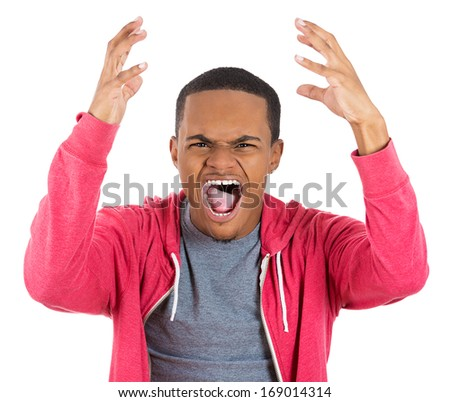 Closeup portrait of upset angry man in red hoodie with hand raised open mouth yelling, isolated on white background. Negative emotion facial expression feelings. Conflict problems and issues