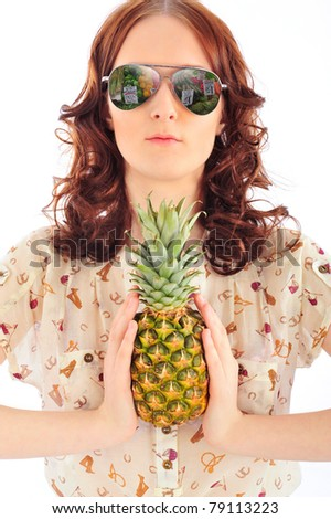 Closeup portrait of woman in sunglasses holding pineapple in her arms. Beautiful market reflecting in her sunglasses. Isolated on white background. Food entertainment concept
