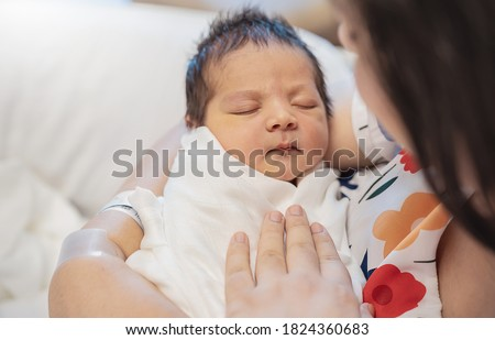 Closeup portrait of young asian Indian mother holding newborn baby with copy space. Healthcare and medical daycare nursery love lifestyle together single mom mother's day holiday concept