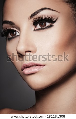 Closeup portrait of young beautiful  woman with long  eyelashes