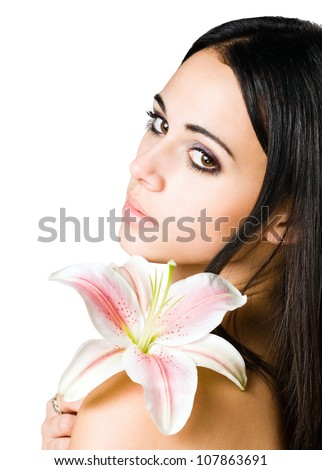 Closeup portrait of young brunette beauty in light makeup.