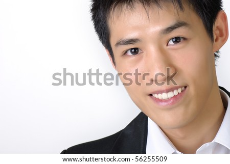 Closeup portrait of young business man of Asian with copyspace on white.