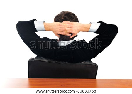 Closeup portrait of young businessman from the back. Sitting with opened arms on his armchair. Isolated over white background