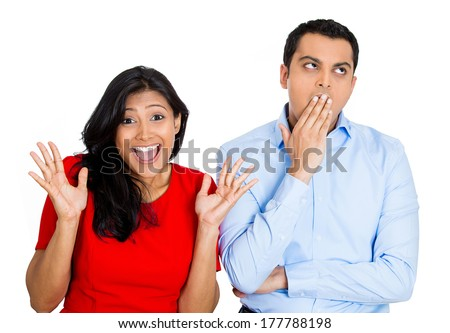 Closeup portrait of young couple, man, woman. One being excited, happy smiling, optimistic, other bored, serious, sleepy, showing no interest, isolated on white background. Emotion, feelings contrasts
