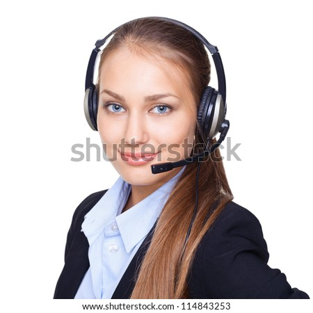 Closeup portrait of young female call centre employee with a headset on white background - stock photo