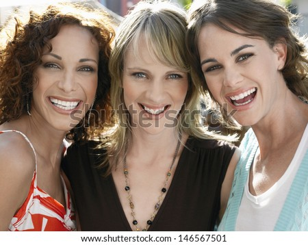 Closeup portrait of young female friends smiling outdoors