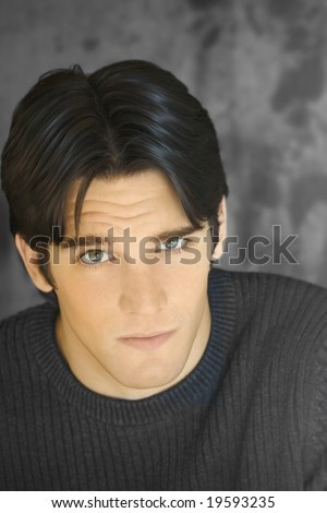 Closeup portrait of young good-looking model