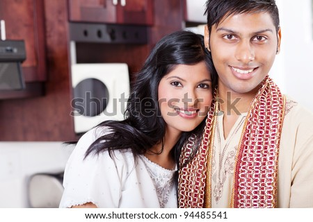closeup portrait of young indian couple hugging