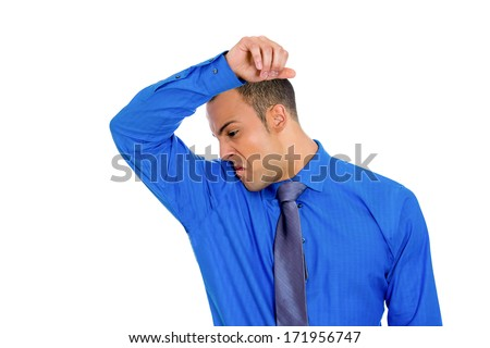 Closeup portrait of young man smelling sniffing his wet for How to get bad smell out of armpits in shirts
