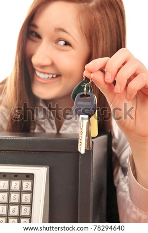 Closeup portrait of young pretty woman at her desk with deposit safe