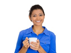 Closeup portrait of young smiling attractive pretty beautiful woman model holding drinking cup beverage, isolated on white background. Positive emotion facial expression feelings.