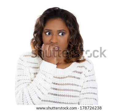 Closeup portrait of young unhappy woman biting her nails and looking away with a craving for something or anxious worried isolated on white background. Negative emotion facial expression feelings