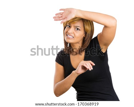 Closeup portrait of young woman looking shocked, scared trying to protect herself in anticipation of an unpleasant situation, isolated on a white background. Negative emotion facial expression feeling