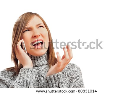 Closeup portrait of young woman talking using her cell phone and looking at copyspace. She is expressive and surprised