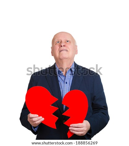 Closeup portrait, old man, senior executive, business man, corporate employee, mature guy, holding broken heart in his hands, about to cry, isolated white background. Human emotions, expressions