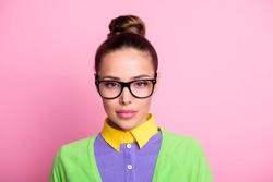 Closeup portrait photo of gorgeous lovely serious calm student girl knot hairstyle confident calm serious look camera lipstick wear glasses colored clothes bright pink color background