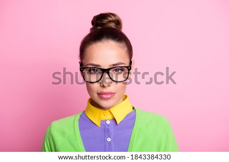 Closeup portrait photo of gorgeous lovely serious calm student girl knot hairstyle confident calm serious look camera lipstick wear glasses colored clothes bright pink color background Photo stock ©