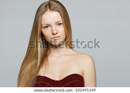 Closeup portrait picture of beautiful woman over grey background