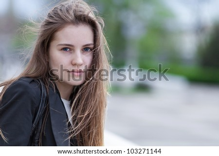 Closeup portrait pretty young woman outdoors