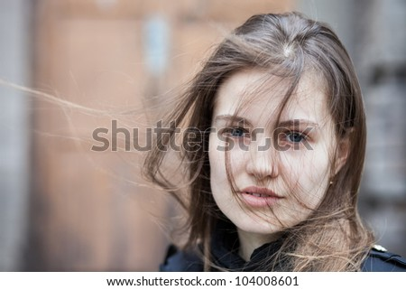 Closeup portrait pretty young woman outdoors
