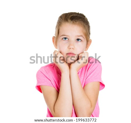 Closeup portrait sad, adorable, little girl wearing pink t-shirt looking thoughtfully up, thinking, daydreaming isolated white background. Human emotions, facial expressions, life perception, worries