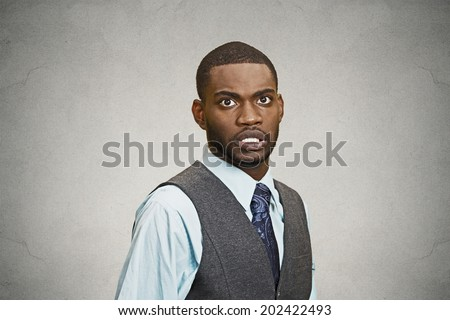 Closeup portrait shocked, stunned, surprised young business man fear in eyes, wide open, scared of something isolated black grey  background. Negative human emotion facial expression, feeling reaction