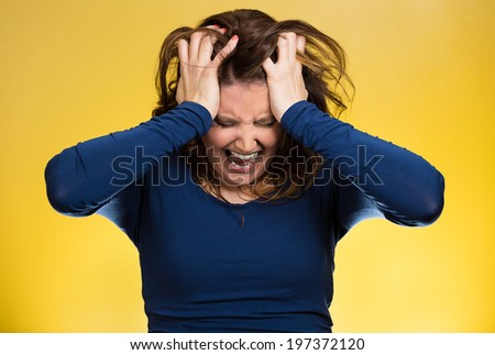 Closeup portrait  stressed business woman, pulling her hair out, yelling, screaming with temper tantrum isolated yellow background. Negative human emotions, facial expressions, reaction attitude