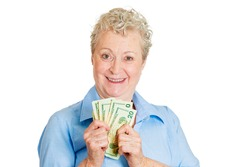 Closeup portrait super happy excited successful senior woman lady holding money dollar bills in hand, isolated white background. Positive emotions, facial expression, feeling. Financial reward savings