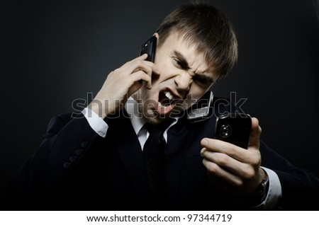 closeup portrait  the  beautiful  businessman careerist in black costume,  call and angry cry