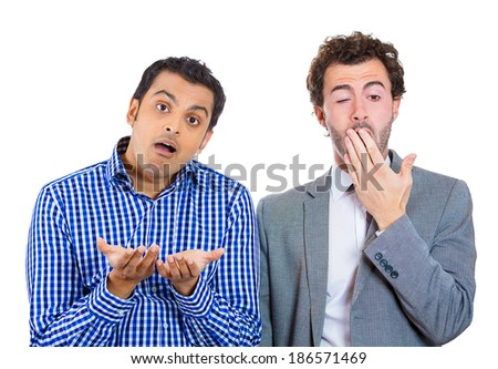 Closeup portrait two young business men. One asking question, alert showing interest, other bored, sleepy, showing no interest, motivation isolated white background. Emotion, feeling, culture contrast