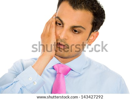 Closeup portrait, very sad, depressed, stressed, alone, defeated disappointed, gloomy young man, hand on cheek, isolated white background. Negative human emotion, facial expression, reaction