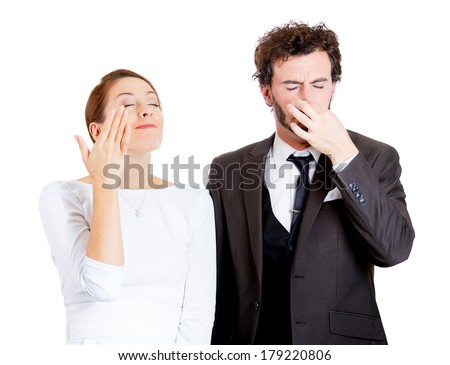 Closeup portrait young couple, man, woman. Female happy smiling, enjoying aroma, male unhappy pinching his nose, disgust on face, hates the smell, isolated on white background. Perception contrast